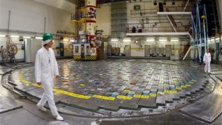 FILE - In this Tuesday, Dec. 15, 2009 file photo, workers walk around Reactor 2 at the Ignalina Nuclear Power Plant in Visaginas, Lithuania, two weeks before the facility was decommissioned. Fuel remains in the reactor core three years after it was shut down due to delays in building a nearby temporary storage facility, raising safety concerns among European officials. The problems have prompted threats from the European Union to sever funding and raising concerns that the facility will be around for years, possibly decades, longer than planned. Europe is learning the hard way that it's one thing to kill a nuclear power station; getting rid of the body is much harder. (AP Photo/Mindaugas Kulbis)